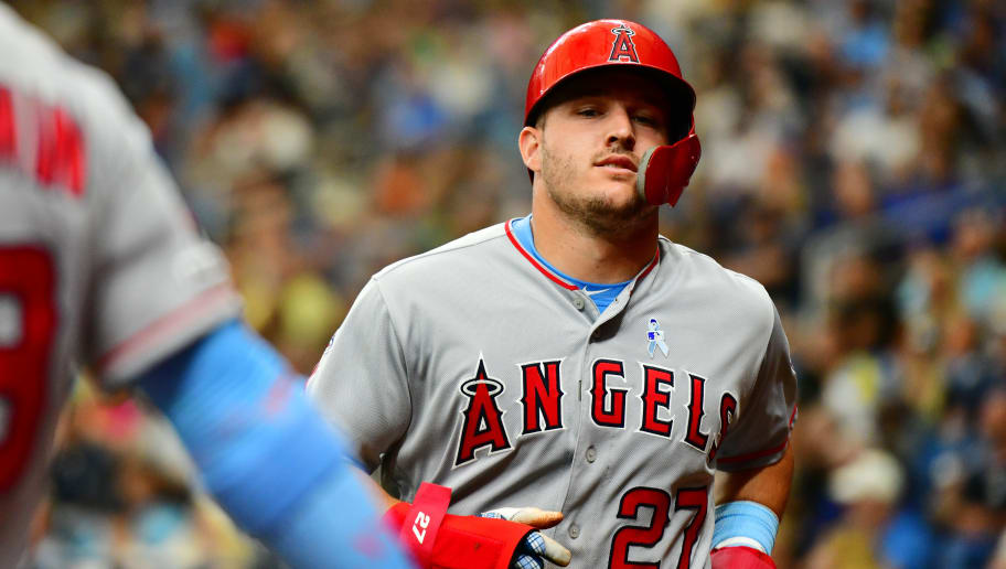 ST. PETERSBURG, FLORIDA - JUNE 16:  Mike Trout #27 of the Los Angeles Angels of Anaheim scores after teammate David Fletcher #6 hit a sacrifice fly out against the Tampa Bay Rays in third inning of a baseball game at Tropicana Field on June 16, 2019 in St. Petersburg, Florida. (Photo by Julio Aguilar/Getty Images)