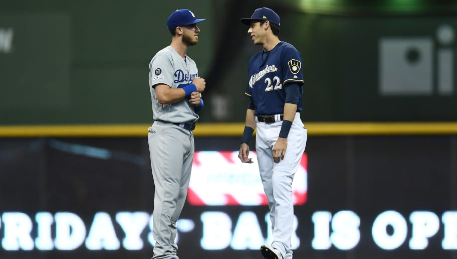 MILWAUKEE, WISCONSIN - APRIL 18:  Cody Bellinger #35 of the Los Angeles Dodgers and Christian Yelich #22 of the Milwaukee Brewers talk prior to a game at Miller Park on April 18, 2019 in Milwaukee, Wisconsin. (Photo by Stacy Revere/Getty Images)