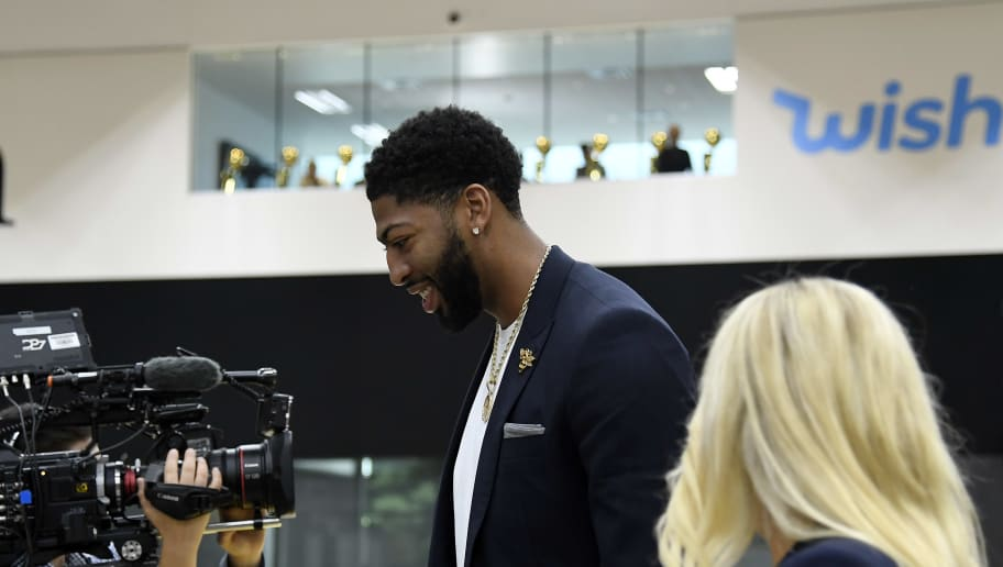EL SEGUNDO, CA - JULY 13: Anthony Davis walks past the championship trophies on display in a window as he  arrives for the press conference to be introduced as the newest player of the Los Angeles Lakers at UCLA Health Training Center on July 13, 2019 in El Segundo, California. NOTE TO USER: User expressly acknowledges and agrees that, by downloading and/or using this Photograph, user is consenting to the terms and conditions of the Getty Images License Agreement. (Photo by Kevork Djansezian/Getty Images)