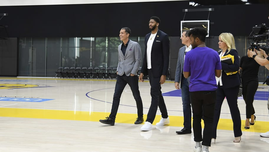 EL SEGUNDO, CA - JULY 13: Anthony Davis (C) arrives for the press conference to be introduced as the newest player of the Los Angeles Lakers with general manager Rob Pelinka (L) and head coach Frank Vogel (R) during a press conference at UCLA Health Training Center on July 13, 2019 in El Segundo, California. NOTE TO USER: User expressly acknowledges and agrees that, by downloading and/or using this Photograph, user is consenting to the terms and conditions of the Getty Images License Agreement. (Photo by Kevork Djansezian/Getty Images)