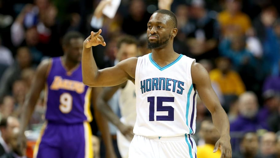 CHARLOTTE, NC - DECEMBER 20:  Kemba Walker #15 of the Charlotte Hornets reacts after making a shot against the Los Angeles Lakers during their game at Spectrum Center on December 20, 2016 in Charlotte, North Carolina. NOTE TO USER: User expressly acknowledges and agrees that, by downloading and or using this photograph, User is consenting to the terms and conditions of the Getty Images License Agreement.  (Photo by Streeter Lecka/Getty Images)