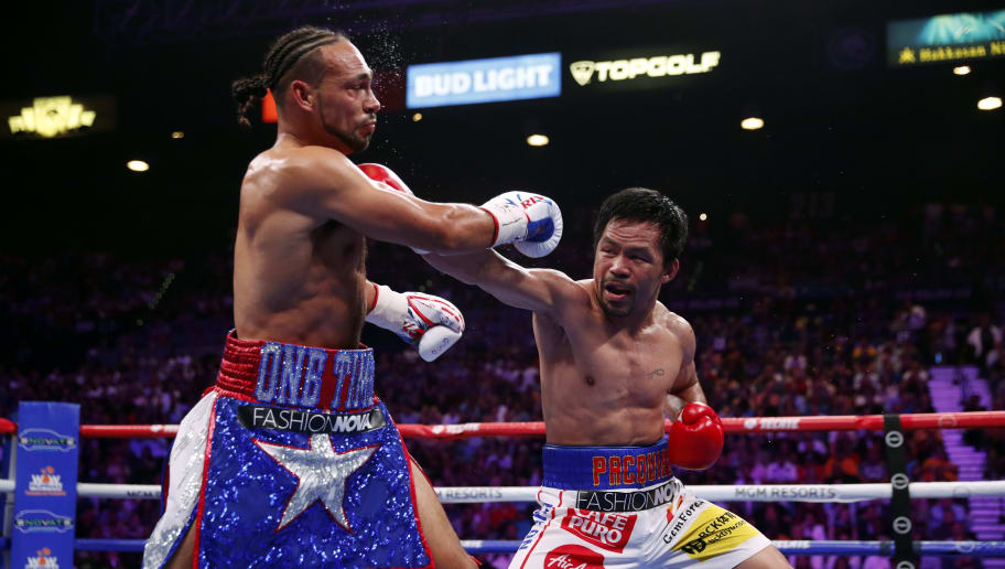 LAS VEGAS, NEVADA - JULY 20:  Manny Pacquiao (R) connects with a punch on Keith Thurman during their WBA welterweight title fight at MGM Grand Garden Arena on July 20, 2019 in Las Vegas, Nevada.  (Photo by Steve Marcus/Getty Images)