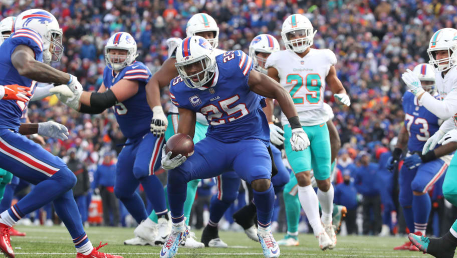 BUFFALO, NY - DECEMBER 30: LeSean McCoy #25 of the Buffalo Bills runs with the ball for a touchdown in the third quarter during NFL game action against the Miami Dolphins at New Era Field on December 30, 2018 in Buffalo, New York. (Photo by Tom Szczerbowski/Getty Images)