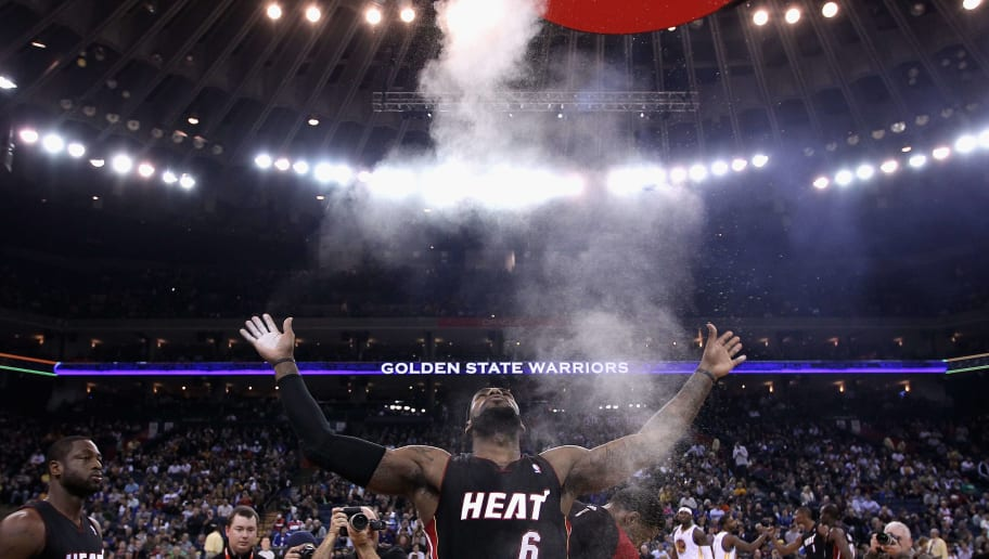 OAKLAND, CA - JANUARY 10:  LeBron James #6 of the Miami Heat throws chalk in to the air before their game against the Golden State Warriors at Oracle Arena on January 10, 2012 in Oakland, California.  NOTE TO USER: User expressly acknowledges and agrees that, by downloading and or using this photograph, User is consenting to the terms and conditions of the Getty Images License Agreement.  (Photo by Ezra Shaw/Getty Images)
