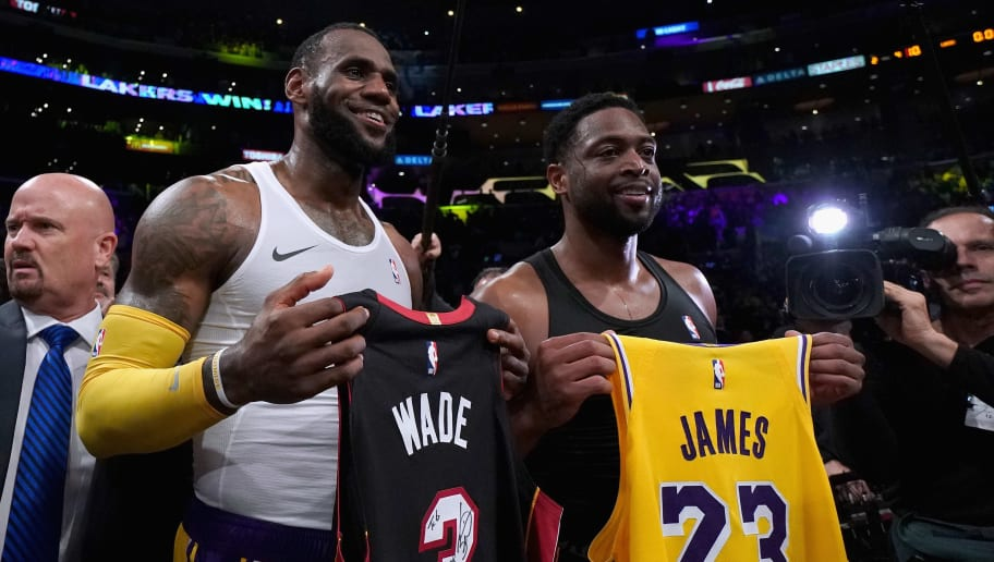 LOS ANGELES, CA - DECEMBER 10:  LeBron James #23 of the Los Angeles Lakers and Dwyane Wade #3 of the Miami Heat pose for a photo after exchanging jerseys, as Wade plans to retire at the end of the season, after a 108-105 Laker win at Staples Center on December 10, 2018 in Los Angeles, California.  NOTE TO USER: User expressly acknowledges and agrees that, by downloading and or using this photograph, User is consenting to the terms and conditions of the Getty Images License Agreement.  (Photo by Harry How/Getty Images)