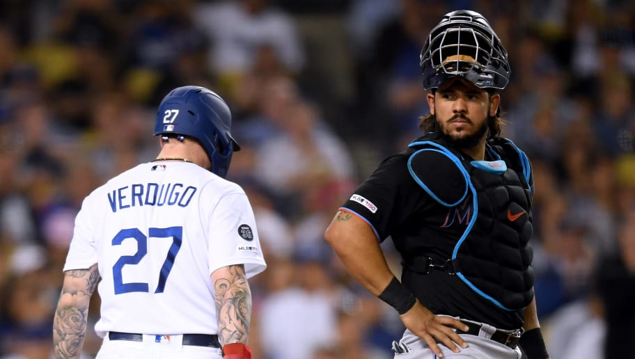 LOS ANGELES, CALIFORNIA - JULY 19:  Jorge Alfaro #38 of the Miami Marlins reacts as Alex Verdugo #27 of the Los Angeles Dodgers scores, for a 1-1 tie, during the sixth inning at Dodger Stadium on July 19, 2019 in Los Angeles, California. (Photo by Harry How/Getty Images)