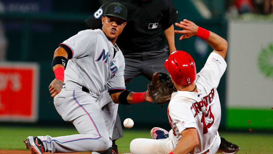 ST LOUIS, MO - JUNE 19: Matt Carpenter #13 of the St. Louis Cardinals steals second base against Starlin Castro #13 of the Miami Marlins in the seventh inning at Busch Stadium on June 19, 2019 in St Louis, Missouri. (Photo by Dilip Vishwanat/Getty Images)
