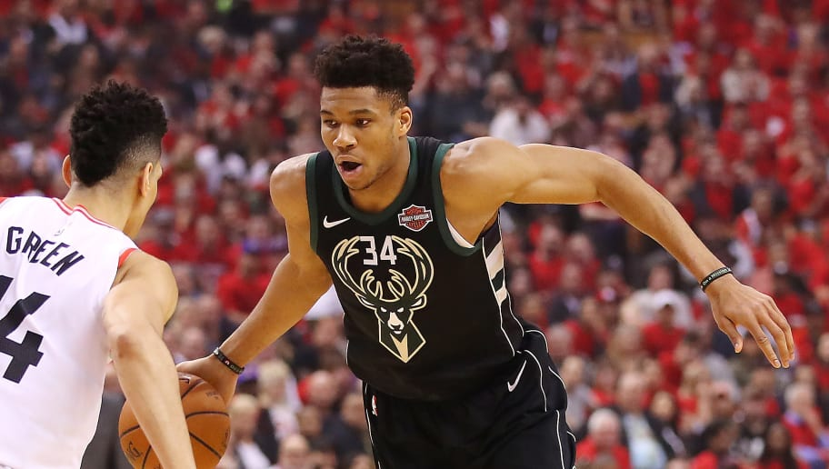 TORONTO, ONTARIO - MAY 25: Giannis Antetokounmpo #34 of the Milwaukee Bucks dribbles against Danny Green #14 of the Toronto Raptors during the first half in game six of the NBA Eastern Conference Finals at Scotiabank Arena on May 25, 2019 in Toronto, Canada. NOTE TO USER: User expressly acknowledges and agrees that, by downloading and or using this photograph, User is consenting to the terms and conditions of the Getty Images License Agreement. (Photo by Gregory Shamus/Getty Images)