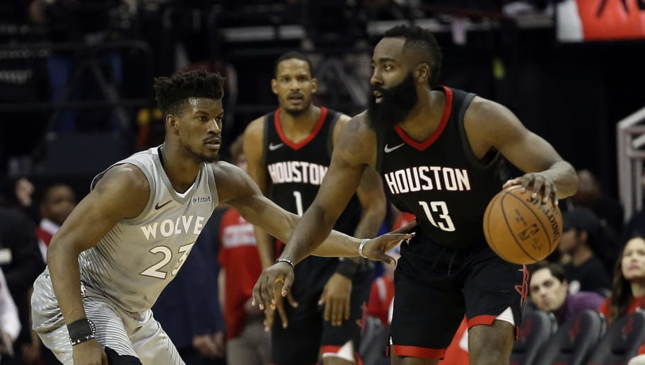 HOUSTON, TX - APRIL 18:  James Harden #13 of the Houston Rockets looks to move on Jimmy Butler #23 of the Minnesota Timberwolves during Game Two of the first round of the Western Conference playoffs at Toyota Center on April 18, 2018 in Houston, Texas. NOTE TO USER: User expressly acknowledges and agrees that, by downloading and or using this photograph, User is consenting to the terms and conditions of the Getty Images License Agreement.  (Photo by Bob Levey/Getty Images)