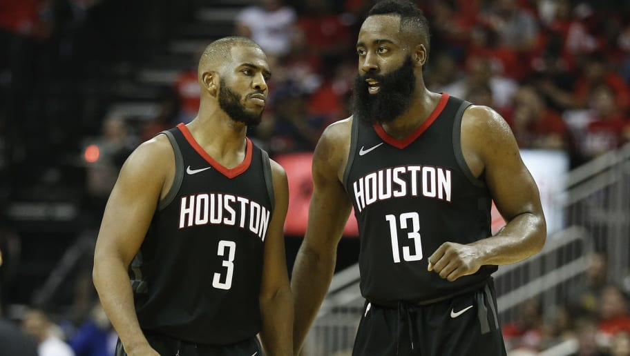 HOUSTON, TX - APRIL 18:  Chris Paul #3 of the Houston Rockets and James Harden #13 talk after comeing out of  time out against the Minnesota Timberwolves during Game Two of the first round of the Western Conference playoffs at Toyota Center on April 18, 2018 in Houston, Texas. NOTE TO USER: User expressly acknowledges and agrees that, by downloading and or using this photograph, User is consenting to the terms and conditions of the Getty Images License Agreement.  (Photo by Bob Levey/Getty Images)