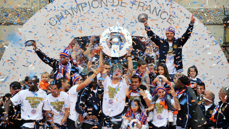 https://images2.minutemediacdn.com/image/upload/c_fill,w_912,h_516,f_auto,q_auto,g_auto/shape/cover/sport/Montpelliers-football-club-players-cele-94d96dbbfcdc2ba7fe4d3032139e8d4d.jpg
