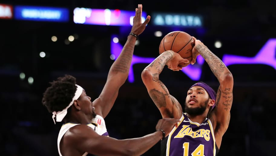 LOS ANGELES, CALIFORNIA - FEBRUARY 27: Brandon Ingram #14 of the Los Angeles Lakers shoots the ball against Jrue Holiday #11 of the New Orleans Pelicans during the second half at Staples Center on February 27, 2019 in Los Angeles, California. NOTE TO USER: User expressly acknowledges and agrees that, by downloading and or using this photograph, User is consenting to the terms and conditions of the Getty Images License Agreement. (Photo by Yong Teck Lim/Getty Images)