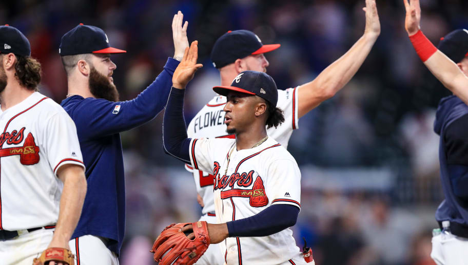 ATLANTA, GA - AUGUST 13: Ozzie Albies #1 of the Atlanta Braves high fives teammates following the 5-3 win against the New York Mets at SunTrust Park on August 13, 2019 in Atlanta, Georgia. (Photo by Carmen Mandato/Getty Images)