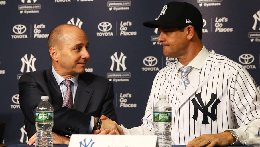 NEW YORK, NY - DECEMBER 06:  Senior Vice President, General Manager Brian Cashman shakes New York Yankee manager Aaron Boone hand at Yankee Stadium on December 6, 2017 in the Bronx borough of New York City.  (Photo by Mike Stobe/Getty Images)