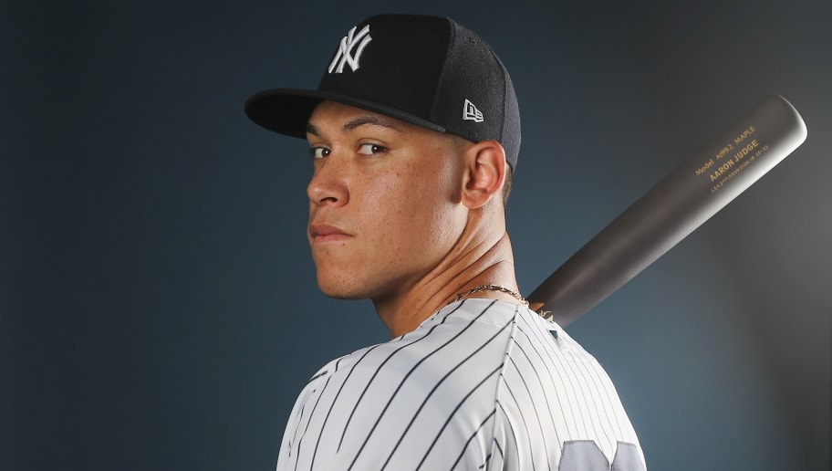 TAMPA, FL - FEBRUARY 21:  Aaron Judge #99 of the New York Yankees poses for a portrait during the New York Yankees photo day on February 21, 2018 at George M. Steinbrenner Field in Tampa, Florida.  (Photo by Elsa/Getty Images)