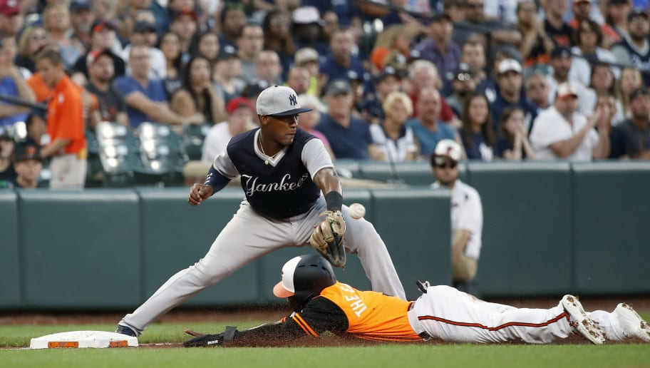 BALTIMORE, MD - AUGUST 24: Cedric Mullins #3 of the Baltimore Orioles is safe at third base against Miguel Andujar #41 of the New York Yankees in the first inning at Oriole Park at Camden Yards on August 24, 2018 in Baltimore, Maryland. (Photo by Patrick McDermott/Getty Images)