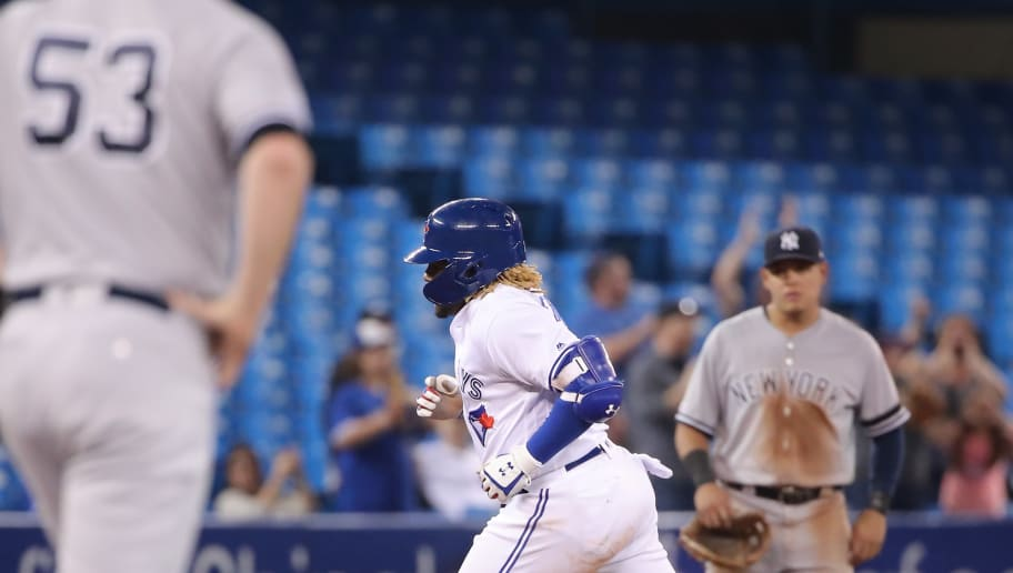 TORONTO, ON - JUNE 05: Vladimir Guerrero Jr. #27 of the Toronto Blue Jays is circles the bases after hitting a three-run home run in the eighth inning during MLB game action as Zack Britton #53 of the New York Yankees reacts at Rogers Centre on June 5, 2019 in Toronto, Canada. (Photo by Tom Szczerbowski/Getty Images)