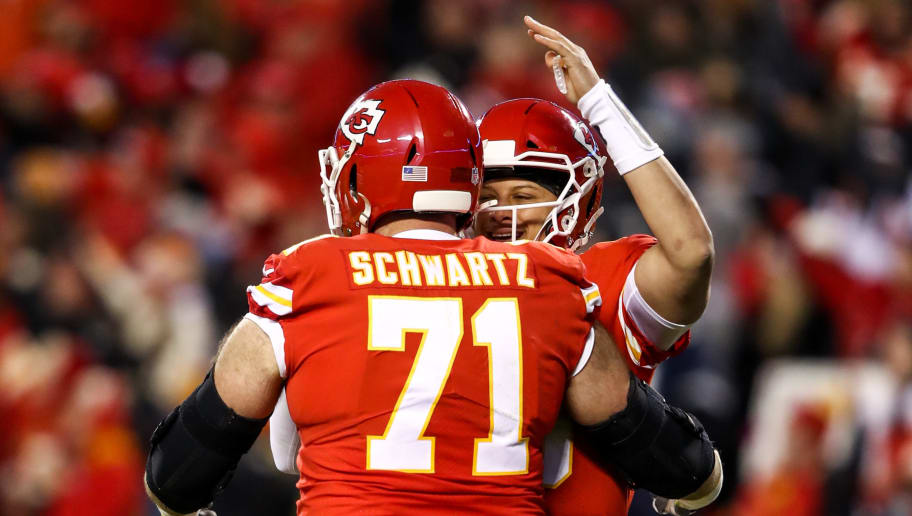 KANSAS CITY, MO - DECEMBER 30: Mitchell Schwartz #71 of the Kansas City Chiefs congratulates teammate Patrick Mahomes #15 on his fiftieth touchdown pass of the season during the third quarter of the game against the Oakland Raiders at Arrowhead Stadium on December 30, 2018 in Kansas City, Missouri. (Photo by Jamie Squire/Getty Images)