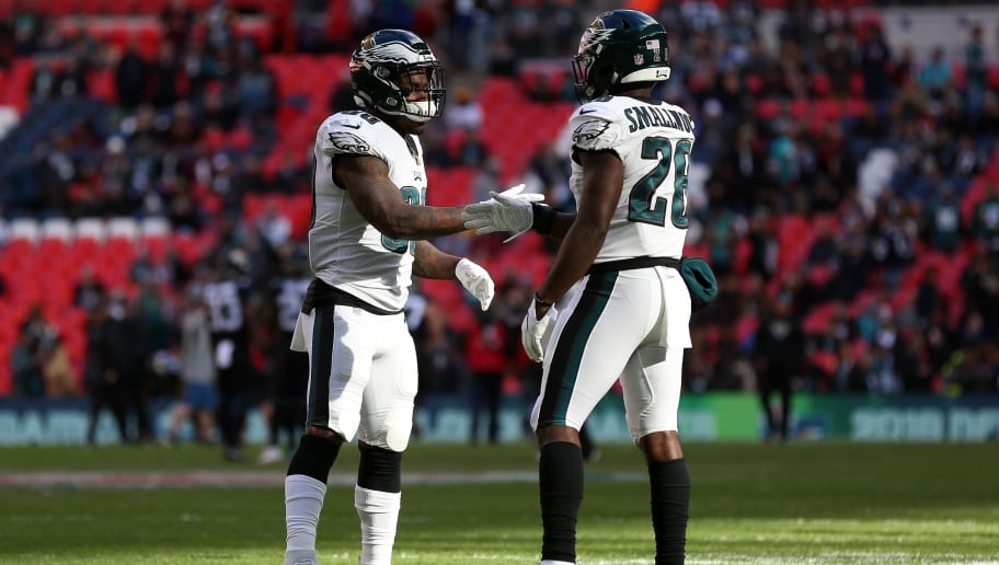 LONDON, ENGLAND - OCTOBER 28: Corey Clement and Wendell Smallwood of The Eagles perform a handshake ahead of the NFL International Series match between Philadelphia Eagles and Jacksonville Jaguars at Wembley Stadium on October 28, 2018 in London, England. (Photo by Kate McShane/Getty Images)
