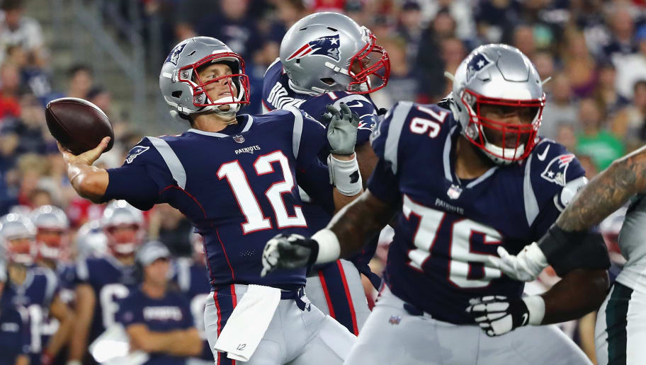 FOXBOROUGH, MA - AUGUST 16:  Tom Brady #12 of the New England Patriots throws a pass in the first half against the Philadelphia Eagles as Isaiah Wynn #76 blocks during the preseason game at Gillette Stadium on August 16, 2018 in Foxborough, Massachusetts.  (Photo by Tim Bradbury/Getty Images)