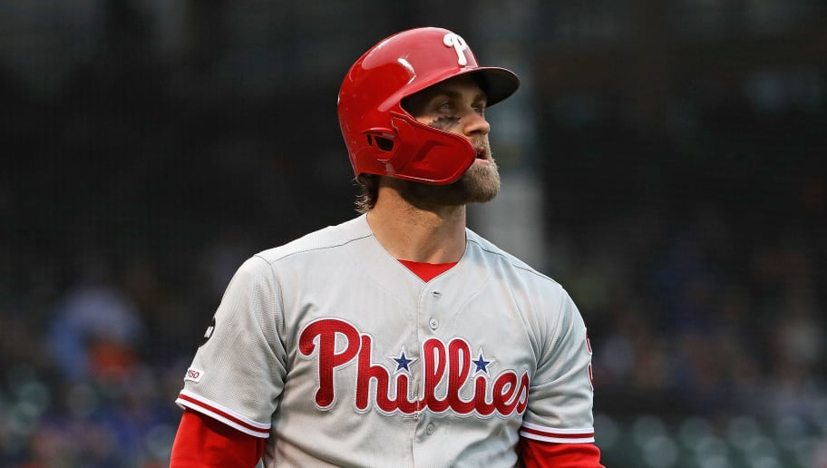 CHICAGO, ILLINOIS - MAY 21: Bryce Harper #3 of the Philadelphia Phillies walks back to the dugout after striking out in the 1st inning against the Chicago Cubs at Wrigley Field on May 21, 2019 in Chicago, Illinois. (Photo by Jonathan Daniel/Getty Images)