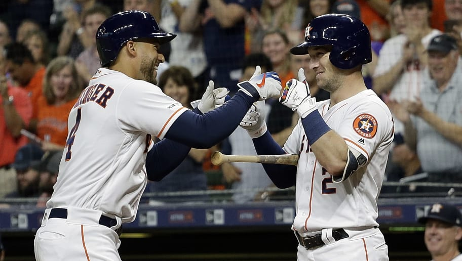 HOUSTON, TEXAS - JUNE 26: George Springer #4 of the Houston Astros receives thumbs up from Alex Bregman #2 after hitting a first inning home run against the Pittsburgh Pirates at Minute Maid Park on June 26, 2019 in Houston, Texas. (Photo by Bob Levey/Getty Images)