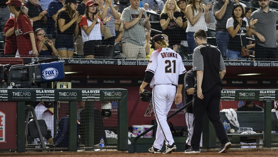 PHOENIX, ARIZONA - MAY 15: Zack Greinke #21 of the Arizona Diamondbacks leaves the game against the Pittsburgh Pirates in the eighth inning with head athletic trainer Ryan DiPanfilo at Chase Field on May 15, 2019 in Phoenix, Arizona. (Photo by Jennifer Stewart/Getty Images)