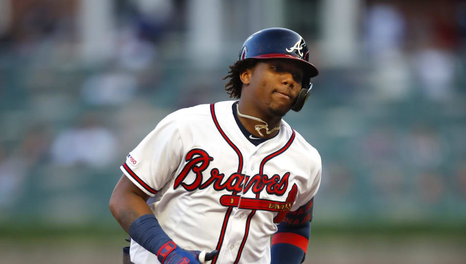 ATLANTA, GA - JUNE 10: Ronald Acuna Jr. #13 of the Atlanta Braves rounds the bases after hitting a grand slam during the second inning of an MLB game against the Pittsburgh Pirates at SunTrust Park on June 10, 2019 in Atlanta, Georgia. (Photo by Todd Kirkland/Getty Images)