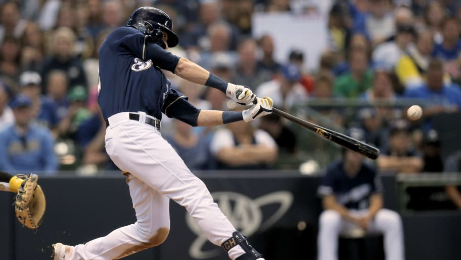 MILWAUKEE, WISCONSIN - JUNE 09:  Christian Yelich #22 of the Milwaukee Brewers hits a home run in the sixth inning against the Pittsburgh Pirates at Miller Park on June 09, 2019 in Milwaukee, Wisconsin. (Photo by Dylan Buell/Getty Images)