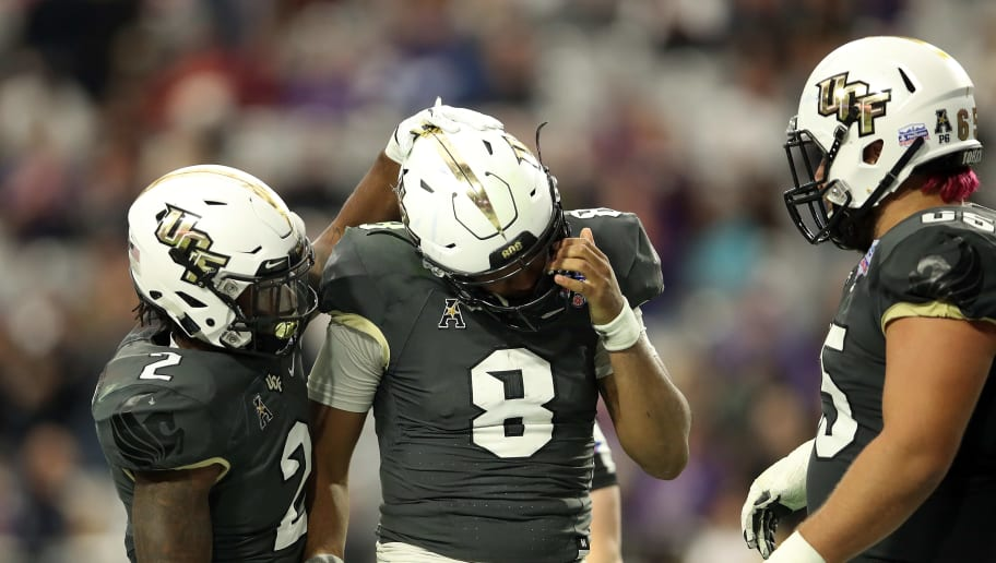 GLENDALE, ARIZONA - JANUARY 01: Running back Otis Anderson #2 hugs teammate quarterback Darriel Mack Jr. #8 of the UCF Knights during the fourth quarter of the PlayStation Fiesta Bowl between LSU and Central Florida at State Farm Stadium on January 01, 2019 in Glendale, Arizona. (Photo by Christian Petersen/Getty Images)