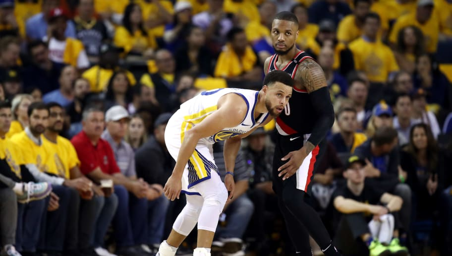 OAKLAND, CALIFORNIA - MAY 14: Stephen Curry #30 of the Golden State Warriors and Damian Lillard #0 of the Portland Trail Blazers look on during the second half in game one of the NBA Western Conference Finals at ORACLE Arena on May 14, 2019 in Oakland, California. NOTE TO USER: User expressly acknowledges and agrees that, by downloading and or using this photograph, User is consenting to the terms and conditions of the Getty Images License Agreement. (Photo by Ezra Shaw/Getty Images)