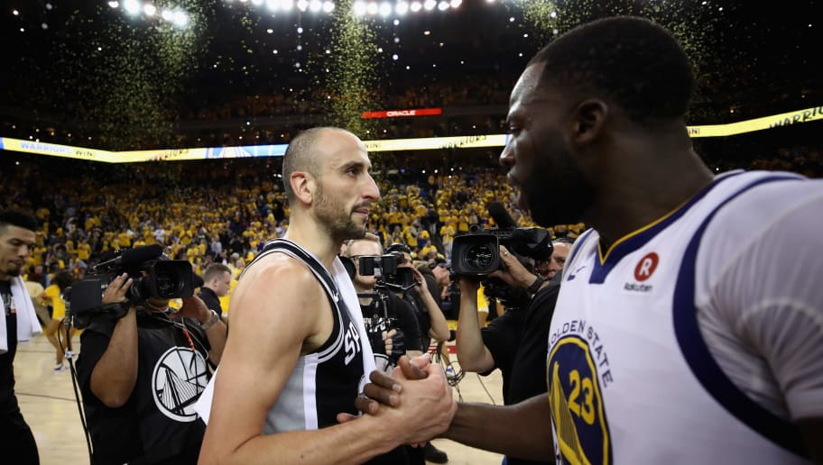 OAKLAND, CA - APRIL 24:  Manu Ginobili #20 of the San Antonio Spurs \shakes hands with Draymond Green #23 of the Golden State Warriors after the Warriors beat the Spurs in Game Five of Round One of the 2018 NBA Playoffs at ORACLE Arena on April 24, 2018 in Oakland, California.  NOTE TO USER: User expressly acknowledges and agrees that, by downloading and or using this photograph, User is consenting to the terms and conditions of the Getty Images License Agreement.  (Photo by Ezra Shaw/Getty Images)