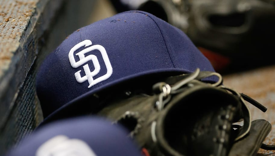 MILWAUKEE, WI - MAY 13:  A line of San Diego Padres hats sits in the dugout during the game against the Milwaukee Brewers at Miller Park on May 13, 2016 in Milwaukee, Wisconsin. (Photo by Dylan Buell/Getty Images)