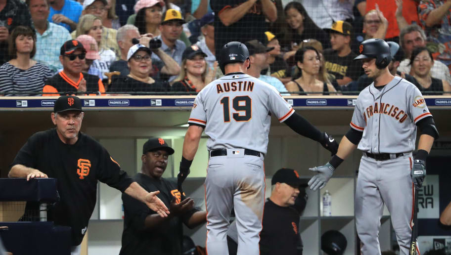 SAN DIEGO, CALIFORNIA - JULY 26:  Tyler Austin #19 o  is congratulated at the dugout by manager Bruce Bochy of the San Francisco Giants after scoring on an RBI double hit by Donovan Solano #7 of the San Francisco Giants during the third inning of a game against the San Diego Padresat PETCO Park on July 26, 2019 in San Diego, California. (Photo by Sean M. Haffey/Getty Images)