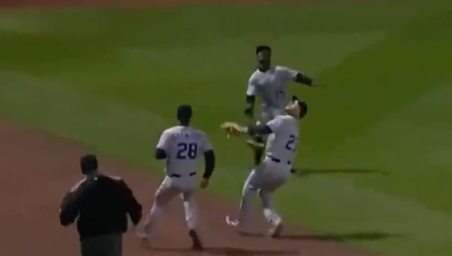 Trevor Story and Raimel Tapia collided while trying to catch a fly ball in left field.