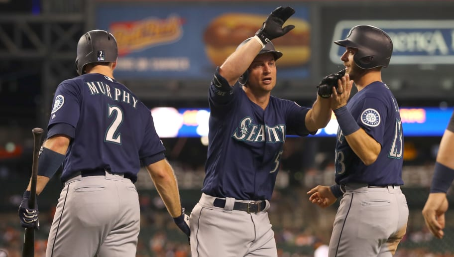 DETROIT, MICHIGAN - AUGUST 13: Kyle Seager #15 of the Seattle Mariners celebrates his sixth inning home run with Tom Murphy #2 and  Austin Nola #23 while playing the Detroit Tigers at Comerica Park on August 13, 2019 in Detroit, Michigan. (Photo by Gregory Shamus/Getty Images)