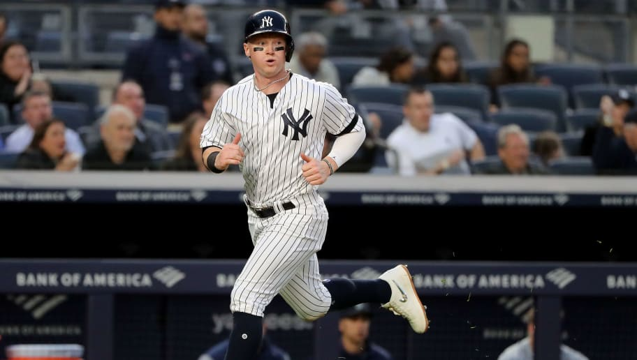 NEW YORK, NEW YORK - MAY 09:  Clint Frazier #77 of the New York Yankees scores in the second inning against the Seattle Mariners at Yankee Stadium on May 09, 2019 in the Bronx borough of New York City. (Photo by Elsa/Getty Images)