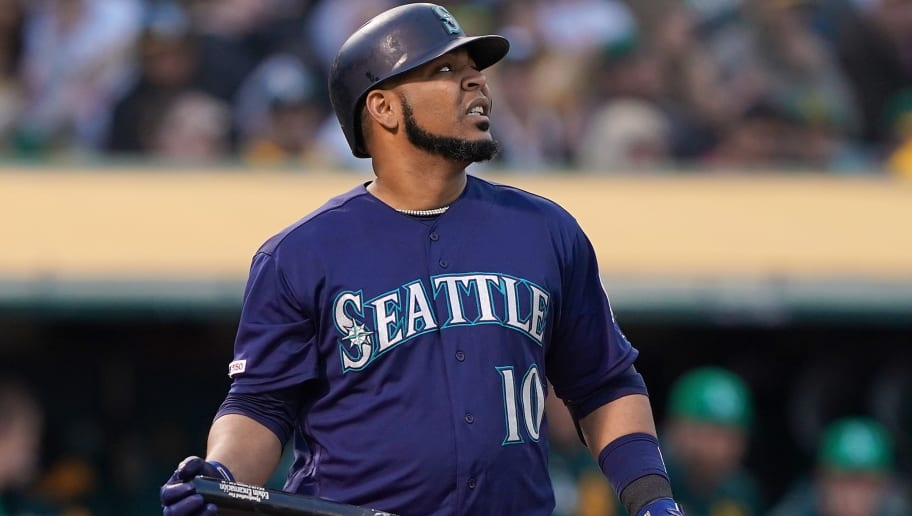 OAKLAND, CA - MAY 24:  Edwin Encarnacion #10 of the Seattle Mariners reacts after striking out against the Oakland Athletics in the top of the second inning of a Major League Baseball game at Oakland-Alameda County Coliseum on May 24, 2019 in Oakland, California.  (Photo by Thearon W. Henderson/Getty Images)