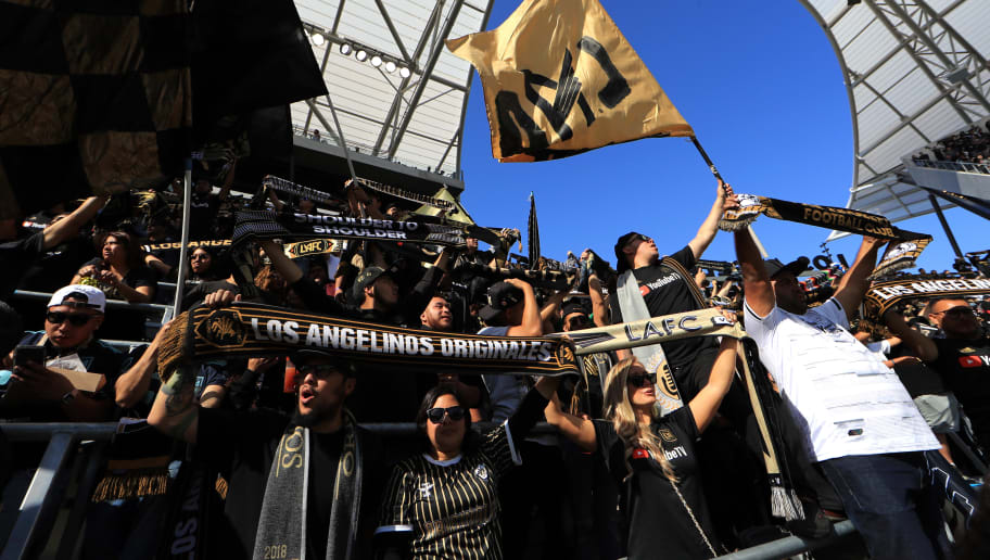 LOS ANGELES, CALIFORNIA - APRIL 21:  Fans of Los Angeles FC cheer during the first half of a game between the Seattle Sounders and the Los Angeles FC at Banc of California Stadium on April 21, 2019 in Los Angeles, California. (Photo by Sean M. Haffey/Getty Images)