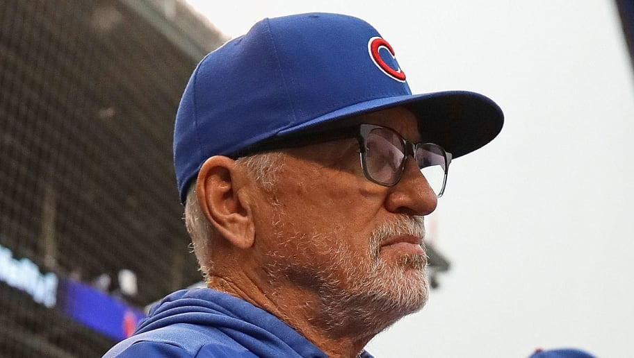 CHICAGO, ILLINOIS - JUNE 09: Manager Joe Maddon #70 of the Chicago Cubs watches as his team takes on the St. Louis Cardinals at Wrigley Field on June 09, 2019 in Chicago, Illinois. (Photo by Jonathan Daniel/Getty Images)