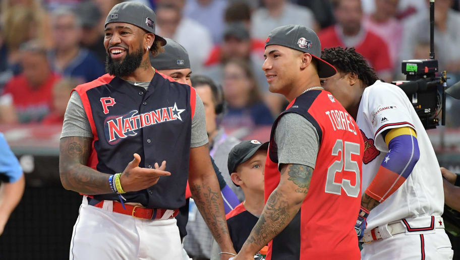 CLEVELAND, OHIO - JULY 08: Josh Bell of the Pittsburgh Pirates and the National League speaks with Gleyber Torres of the New York Yankees and the American League and Ronald Acuna Jr. of the Atlanta Braves and the National League during the T-Mobile Home Run Derby at Progressive Field on July 08, 2019 in Cleveland, Ohio. (Photo by Jason Miller/Getty Images)