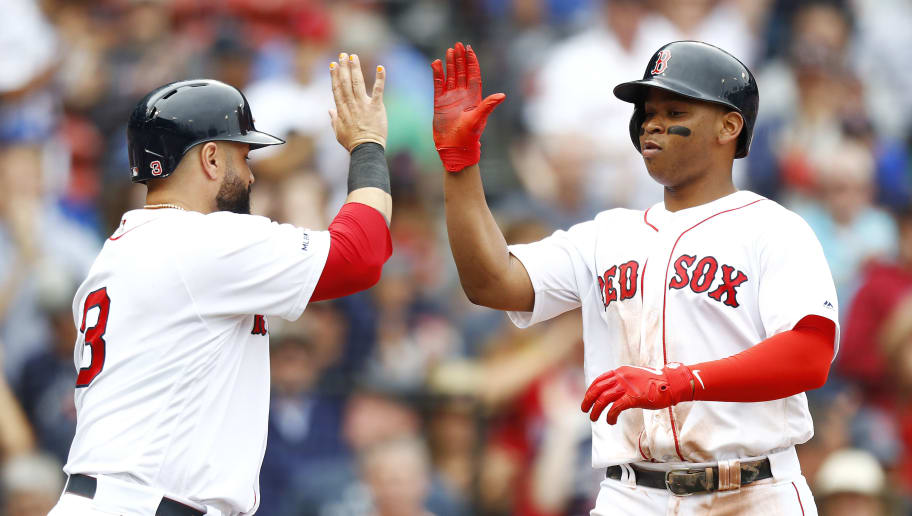 BOSTON, MASSACHUSETTS - JULY 18: Rafael Devers #11 of the Boston Red Sox high-fives Sandy Leon #3 of the Boston Red Sox after hitting a 2 RBI home run in the bottom of the fifth inning of the game against the Toronto Blue Jays at Fenway Park on July 18, 2019 in Boston, Massachusetts. (Photo by Omar Rawlings/Getty Images)