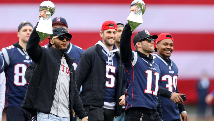 BOSTON, MASSACHUSETTS - APRIL 09: Patrick Chung and Julian Edelman of the New England Patriots lift Lombardi Trophies before the Red Sox home opening game between the Red Sox and the Toronto Blue Jays at Fenway Park on April 09, 2019 in Boston, Massachusetts. (Photo by Maddie Meyer/Getty Images)