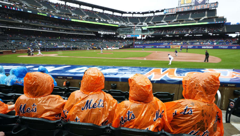 NEW YORK, NY - MAY 16:  New York Mets fans sit in the rain watching the New York Mets play against the Toronto Blue Jays during their game at Citi Field on May 16, 2018 in New York City.  (Photo by Al Bello/Getty Images)