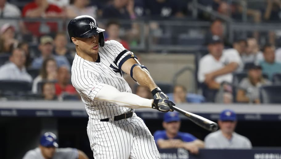 NEW YORK, NEW YORK - JUNE 24: Giancarlo Stanton #27 of the New York Yankees hits a three run home run against the Toronto Blue Jays in the sixth inning at Yankee Stadium on June 24, 2019 in New York City. (Photo by Michael Owens/Getty Images)