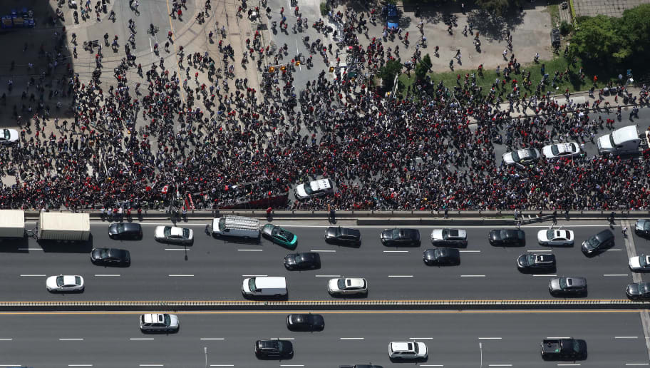 TORONTO, ON - JUNE 17: Fans stop on the Gardiner Expressway as they watch the Toronto Raptors NBA Championship Victory Parade after defeating the Golden State Warriors in the Finals on June 17, 2019 in Toronto, Canada. NOTE TO USER: User expressly acknowledges and agrees that, by downloading and or using this photograph, User is consenting to the terms and conditions of the Getty Images License Agreement. (Photo by Tom Szczerbowski/Getty Images)