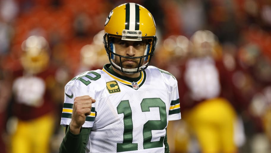 LANDOVER, MD - JANUARY 10: Quarterback Aaron Rodgers #12 of the Green Bay Packers celebrates after the Green Bay Packers defeated the Washington Redskins 35-18 during the NFC Wild Card Playoff game at FedExField on January 10, 2016 in Landover, Maryland. (Photo by Rob Carr/Getty Images)