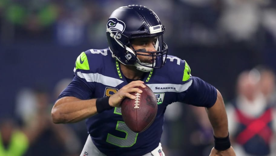 ARLINGTON, TEXAS - JANUARY 05: Russell Wilson #3 of the Seattle Seahawks scrambles in the pocket against the Dallas Cowboys in the first half during the Wild Card Round at AT&T Stadium on January 05, 2019 in Arlington, Texas. (Photo by Tom Pennington/Getty Images)