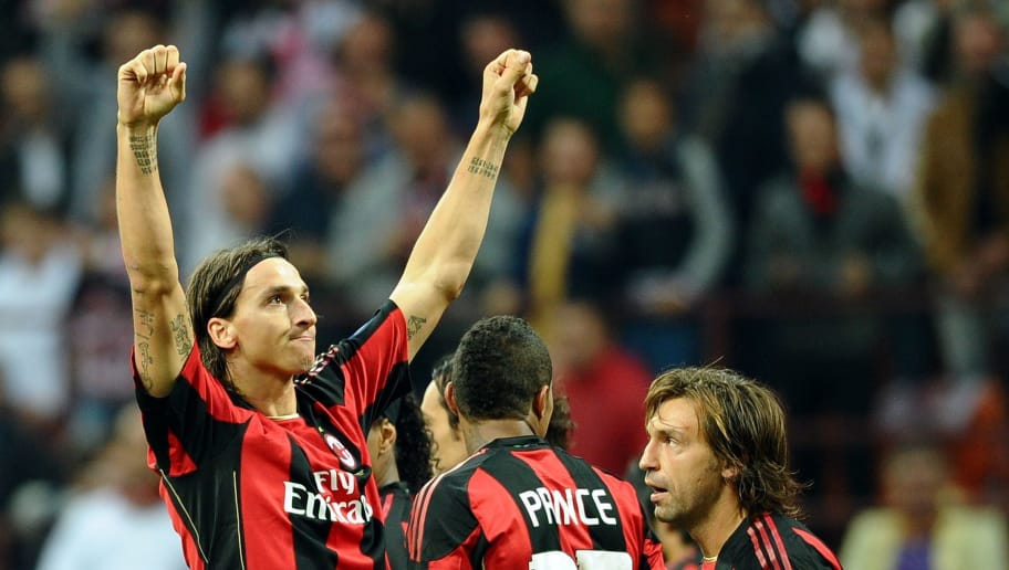 A.C. Milan's Swedish forward Zlatan Ibrahimovic (L) celebrates with teammates after scoring against Genoa during their Series A football match at Meazza stadium in Milan on September 25, 2010.    AFP PHOTO / VINCENZO PINTO (Photo credit should read VINCENZO PINTO/AFP/Getty Images)