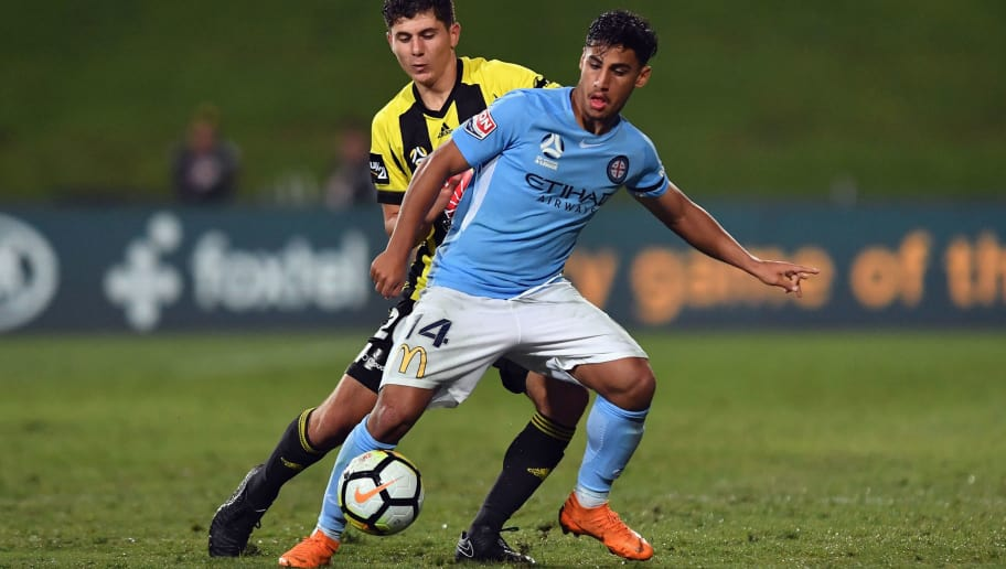 AUCKLAND, NEW ZEALAND - APRIL 14: Daniel Arzani of Melbourne City controls the ball from  Liberato Cacace of the Phoenix during the round 27 A-League match between the Wellington Phoenix and Melbourne City FC at QBE Stadium on April 14, 2018 in Auckland, New Zealand.  (Photo by Kai Schwoerer/Getty Images)